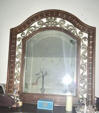 Brown wooden framed wall mirror 797 km