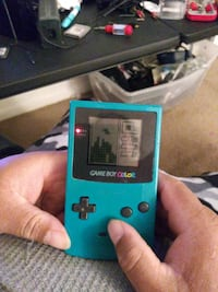 Game boy and 3 games Tetris Monopoly and Tony Hawk Pro Skate 2