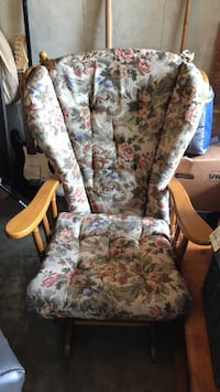 white and blue floral wing chair
