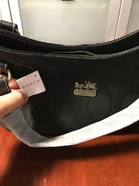monogrammed black Coach bag with tags