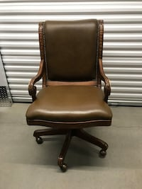 Amazing executive leather & gorgeous carved wood swivel, rock back chair on rollers Englewood, 80112