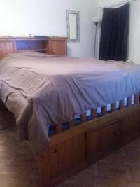 brown wooden bed frame with brown bed blanket Dallas, 75216