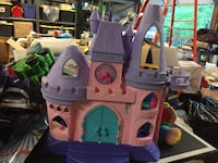 Purple, pink, and blue plastic castle dollhouse Portland, 37148