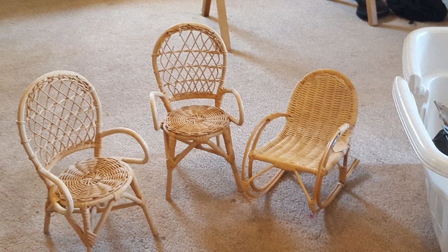 three brown wicker armchairs and rocking chair