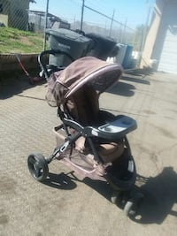 baby's black and brown jogging stroller
