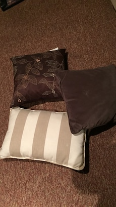 Six neutral pillows