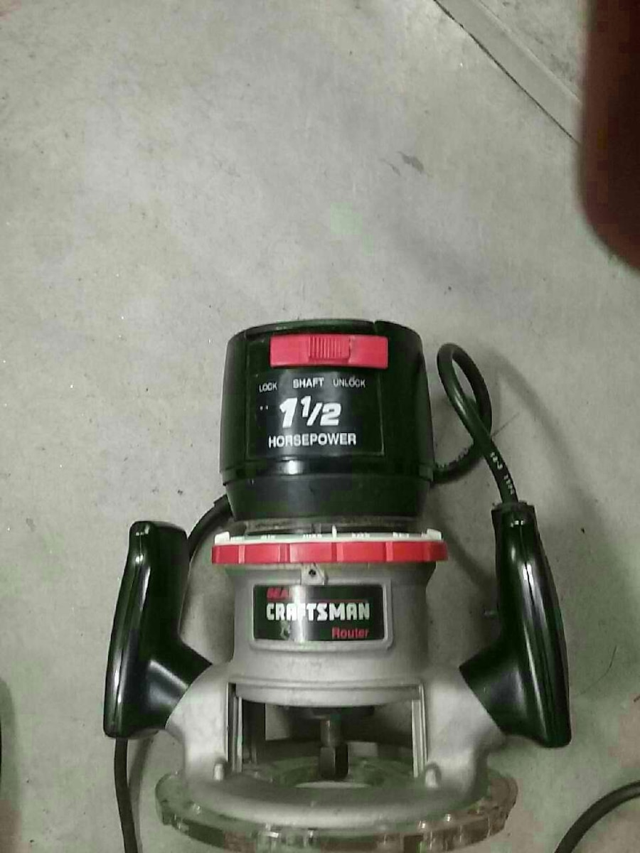 grey and black Craftsman wood router
