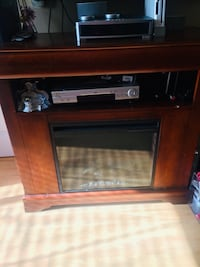 Brown wooden tv stand with cabinet and electric fire place. Rockville, 20852