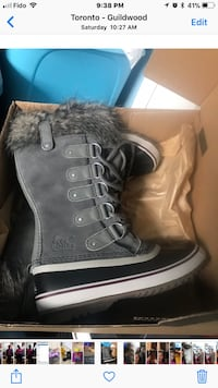 pair of gray-and-black Sorel sheepskin duck boots with box screenshot