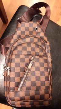 damier ebene Louis Vuitton leather backpack