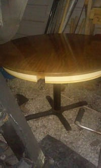round brown wooden pedestal table Berea