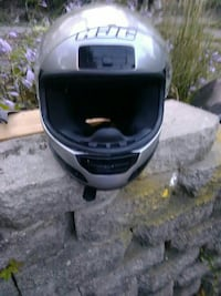 silver and black RJC full face motorcycle helmet