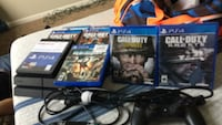 black Sony PS4 console with controller and game cases Olive Branch, 38654