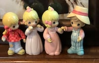 Set of 4 precious moments figurines with movable arms and legs made in 2002 in new condition! Porch pick up in gr Grand Rapids, 49544