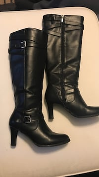 Pair of black l knee-high boots size 8