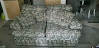 gray and white floral fabric loveseat Calgary