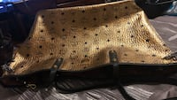 Gold and black monogrammed mcm leather tote bag