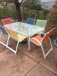 Patio table, 6 chairs,  2 lounge chat, umbrella & stand.  Champlin, 55316