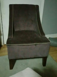 brown wooden framed purple suede  padded armchair