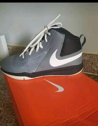 pair of gray-and-white Nike basketball shoes