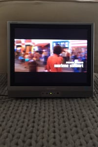 """Sharp Aquos 15"""" TV with power supply, remote and stand"""