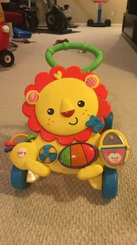 Yellow and red fisher price musical lion walker for toddler Carmel, 46032