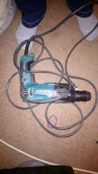 blue and black Makita corded power tool 3157 km