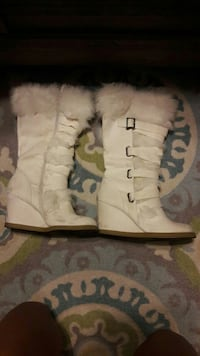 women's pair of white boots