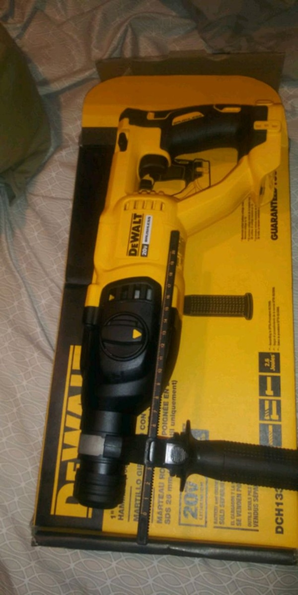 black and yellow Dewalt power tool