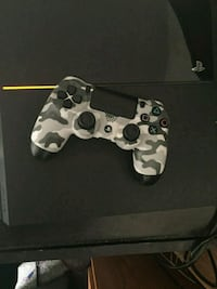 black Sony PS4 1 controller and 2 games