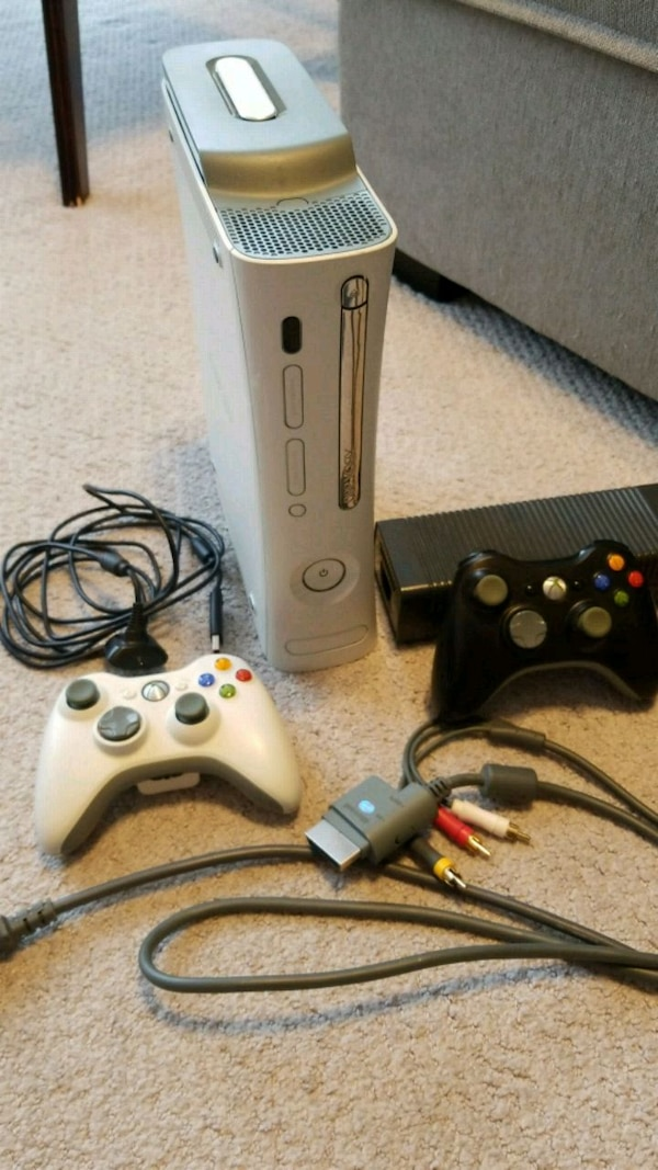 Xbox 360 with 2 controllers and rechargeable batt