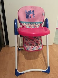 baby's red and pink Babay Alive highchair