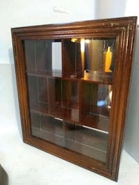 Wood and glass cabinet 24 in mirror back