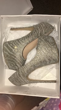 pair of gray leather studded closed-toe platform stiletto shoes with white box Omaha, 68112