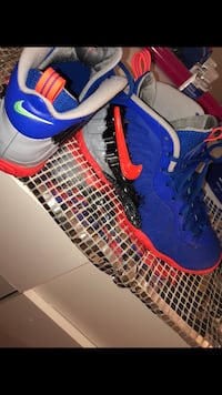 pair of blue-and-red Nike basketball shoes District Heights, 20747