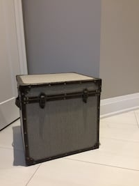 Decorative canvas and leather storage trunk.