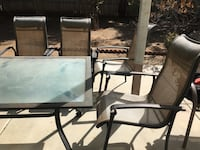 Table and chairs umbrella 2 people flaked already need gone Vista, 92084