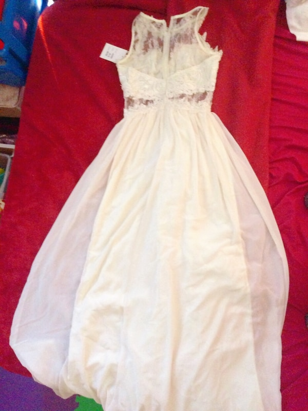 women's white sleeveless dress 77d09e0f-bd58-494b-a7d7-226a6559b061