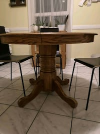rectangular brown wooden table with four chairs dining set Toronto, M6H 3S4