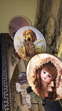 three assorted painted decorative plates