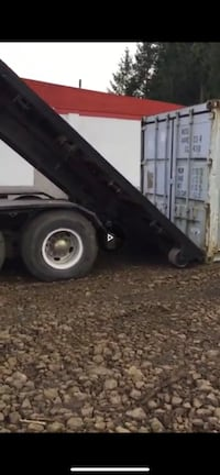 Continues chain roll off dumpster truck. Runs great