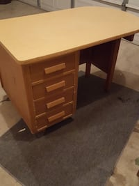 nice medium-sized table with three drawers