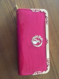 Pink and silver clutch wallet