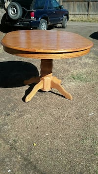 brown wooden framed pedestal table