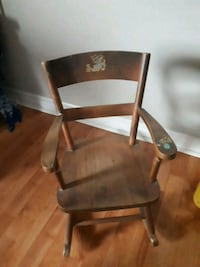brown wooden chair with black metal base Peterborough, K9J 7G8