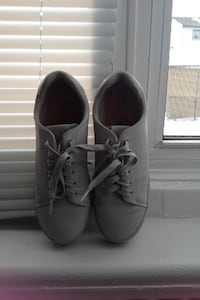 pair of grey low-top sneakers