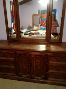brown wooden sideboard with mirror
