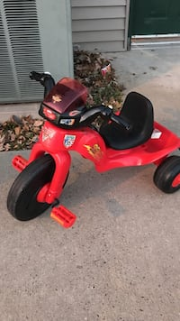 toddler's red and black trike