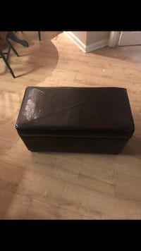 black leather padded ottoman 34 km