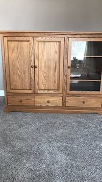 Solid oak tv cabinet. Must pick up Maple Ridge, V2X 1C3